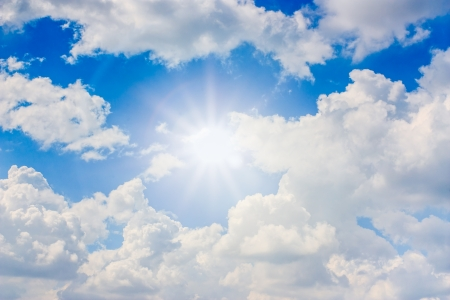 blue sky with sun ray and white clouds