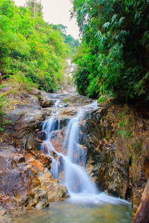 Waterfall in forest of Thailand National Park, in the dry season  photo