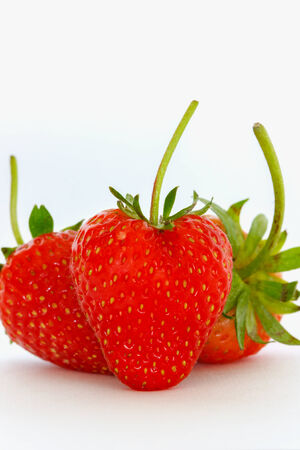 palatable: Fruit strawberry bright red palatable on white background  Stock Photo