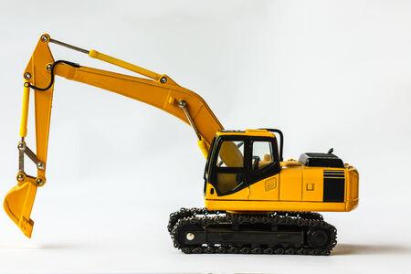 crawler: Yellow Crawler Excavator on Model white background  Stock Photo