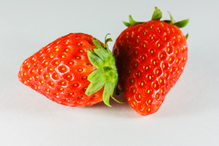 Fruit strawberry bright red to eat on white background  photo