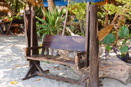 A Swing bench, sit   beachside of the restaurant  photo