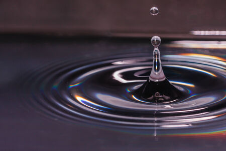 Drops of water of life, with a gray  background  photo