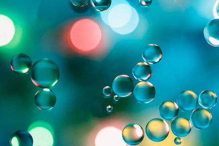 close up oil floating on water colorful  beautiful  with  lights photo
