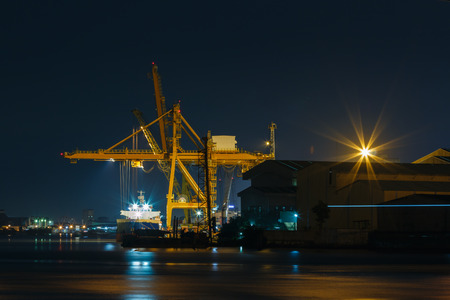 bangkok night: Commercial docks at  night with a ship and cranes