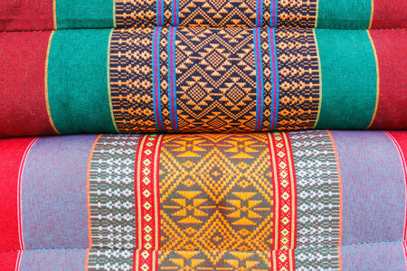 Thai traditional pattern in the on pillow craft used as a background. photo