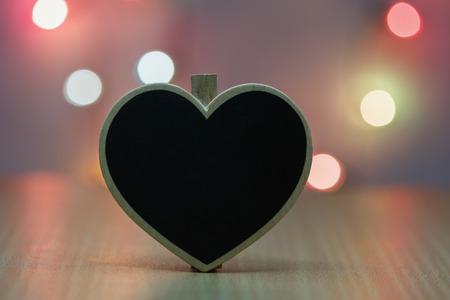 lighting background: Black wood heart with background lighting. Stock Photo