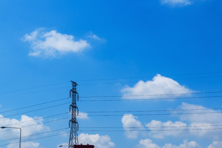 megawatts: High voltage pole with a blue sky and as clouds background