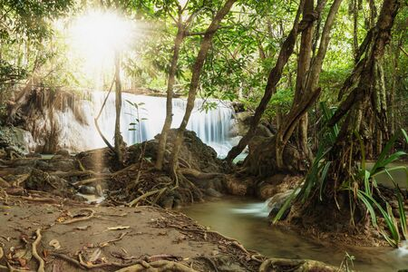 kamin: Waterfalls Huay Mae Kamin with sunlight from the sun in National Park  in Kanchanaburi Province, Thailand. Stock Photo