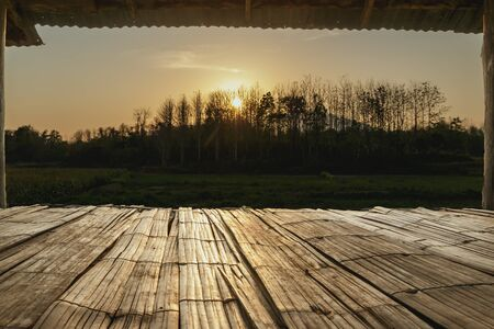 Bamboo flooring with the sunset in the countryside photo
