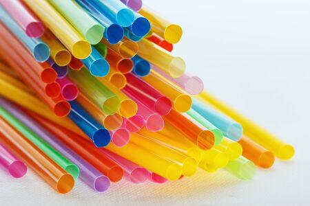 Multi Color flexible straws  on  white background photo