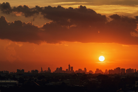 Sunset at city  with  of building silhouette in bangkok photo