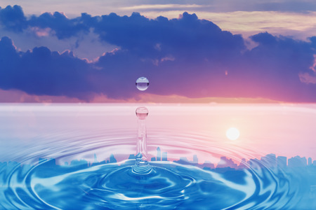 sky reflection: Water droplet with cloud and sunset sky   reflection Stock Photo
