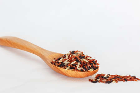 ladle: Concepts,Jasmine Brown Rice  on wooden ladle