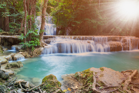 huay: Waterfall Huay Mae Kamin, with dawn beautiful  in  forest deep  quiet of Thailand Stock Photo