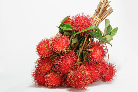 thailand fruit: Bunch Rambutan fruit with green leaf  on white background,Thailand fruit