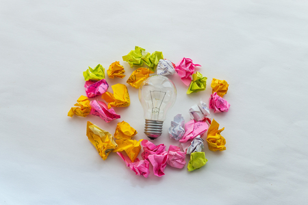 good idea: Good idea concept with crumpled colorful paper and light bulb on white background