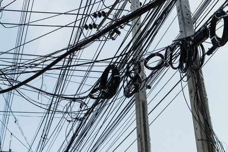 Electrical cables with telephone lines tangled  messy in Bangkok city, Thailand