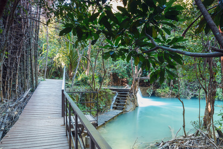Wooden walkways and waterfalls in  National Park, Thailand