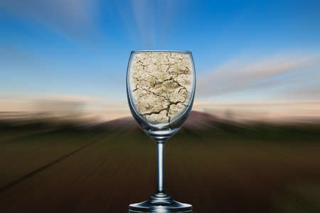 compared: Concept, the dry ground in a glass of wine on the background blurred, compared to solve the problem, disaster vultures. Stock Photo