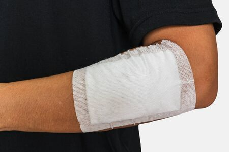 human body substance: Left arm of a male has been injured on white background Stock Photo