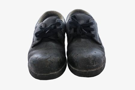 zapatos de seguridad: Zapatos de seguridad sobre un fondo blanco.