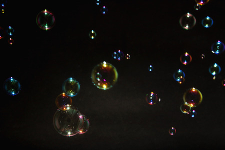 air bubbles: Blurred colorful air bubbles from the soap bubbles on background.