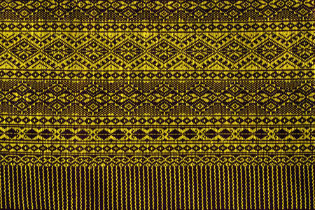 abstract backgrounds: Thai fabric texture background with yellow pattern beautiful