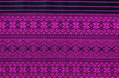 abstract background: Thai fabric texture background with purple pattern beautiful