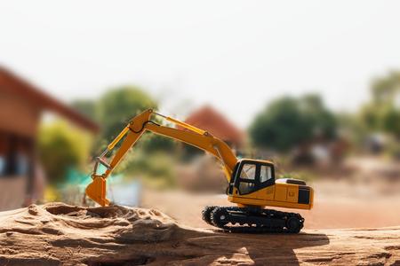 back hoe: Excavator model on wooden Stock Photo