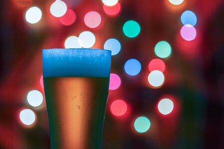 intoxicant: Glass of beer on the bokeh lights background .