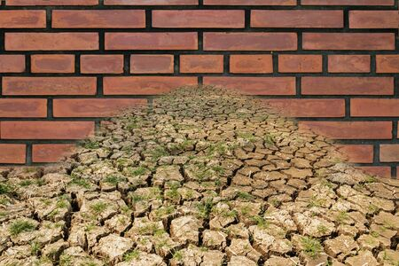 blocking: Concept, brick walls blocking drought,Cracks during  of the soil,( trade barriers) Stock Photo