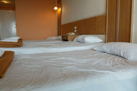 bedder: White pillows on a bed in room