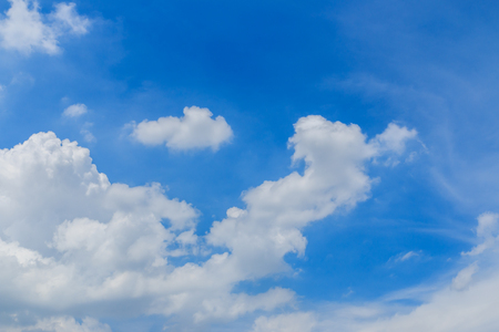 fluffy clouds: Blue Sky with white fluffy clouds Stock Photo