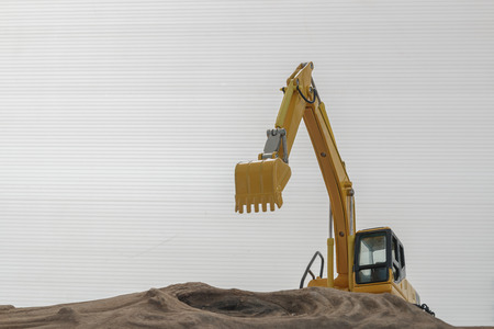 Excavator model on wooden with white future board background