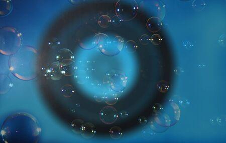 Rainbow soap bubbles on a blue dark backgrounds