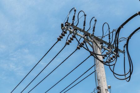 High-voltage wires on a light pole.