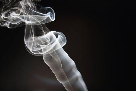 White smoke with dark backgrounds