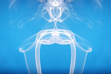 White smoke shape on a blue  backgrounds Stock Photo