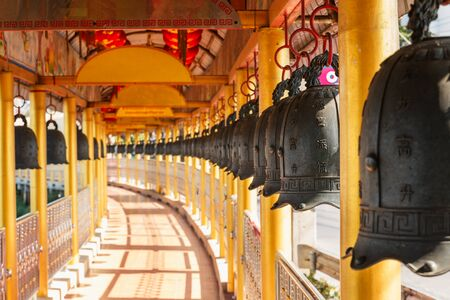 Bells with Chinese characters in  hanging buddhism Stock Photo