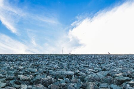 stone background with blue sky and clouds