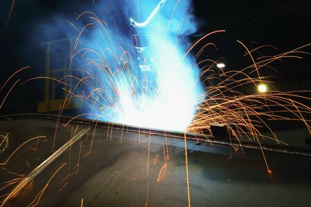 Sparks and smoke from robot welding  in industrial