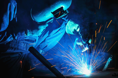 Metal Welding with sparks and smoke of manufacturing Stock Photo
