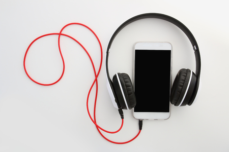 Headphones   isolated on white background ,Concept listen to music from smartphone