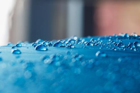 Rain Water droplets on  blue waterproof fabric
