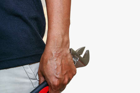 crescent wrench: Man hand hold  Adjustable Wrench ,scroll   on white background Stock Photo