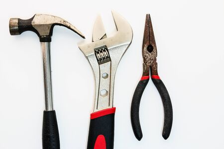 Hand tools with Adjustable Wrenches, hammers and  pliers on white backgrounds Stock Photo