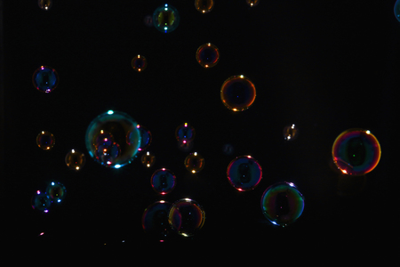 Rainbow soap bubbles on a black background
