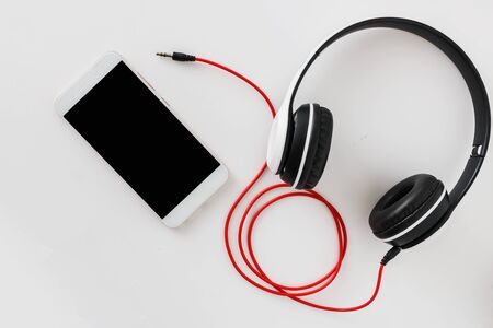 Headphones and smartphones   on white background ,Concept listen to music