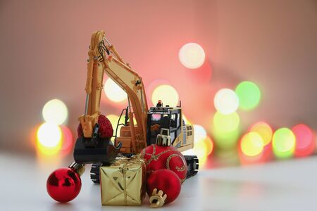 Christmas ornament and Excavator model ,  Holiday celebration concept new year